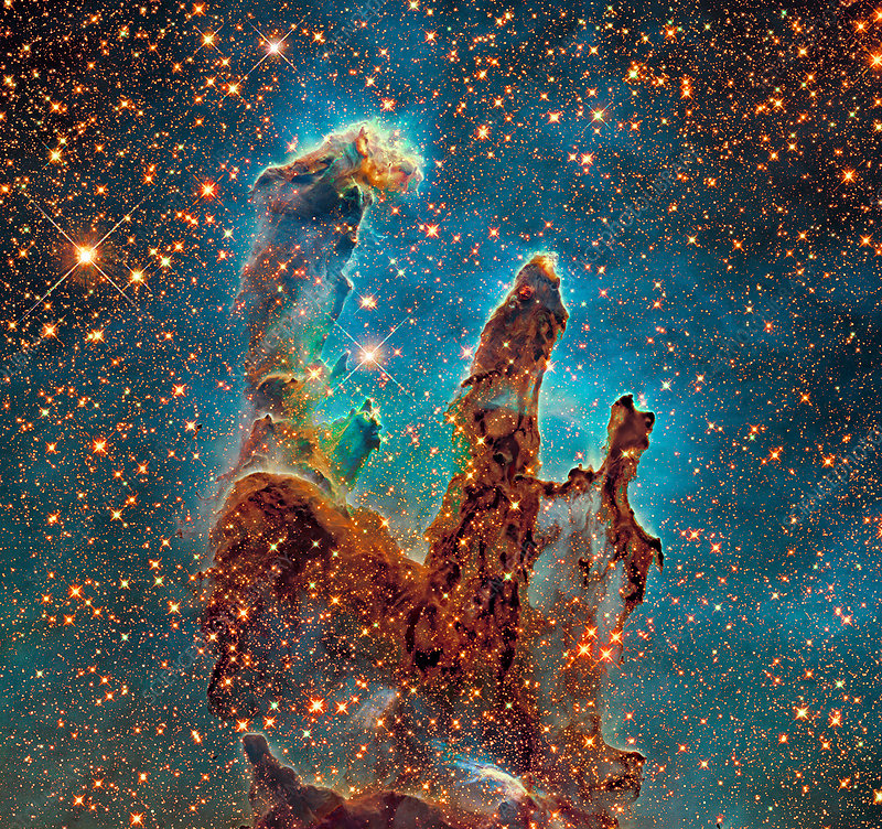 Eagle Nebula's Pillars of Creation, composite image. These towering columns are formed of interstellar hydrogen gas and dust. They are part of the Eagle Nebula (M16), a region of active star formation located 6500 light years away in the Serpens constellation. This image combines visible and infrared data, and is from the Hubble Legacy Archive of images from the Hubble Space Telescope. The original 'Pillars of Creation' image was published in 1995.
